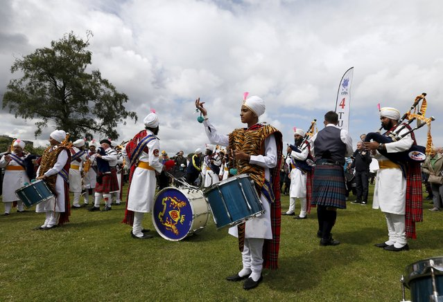 Members of the Sri Dasmesh Pipe Band from Malaysia warm up before competing in the annual World Pipe Band Championships at Glasgow Green, Scotland August 15, 2015. (Photo by Russell Cheyne/Reuters)