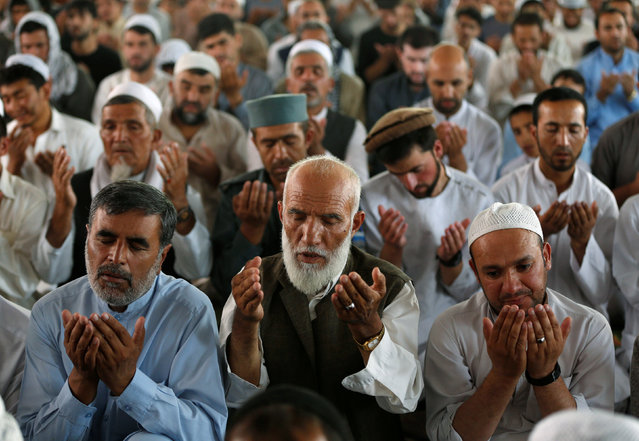 Afghan men pray inside a mosque during the last Friday prayer of the holy month of Ramadan in Kabul, Afghanistan July 1, 2016. (Photo by Omar Sobhani/Reuters)