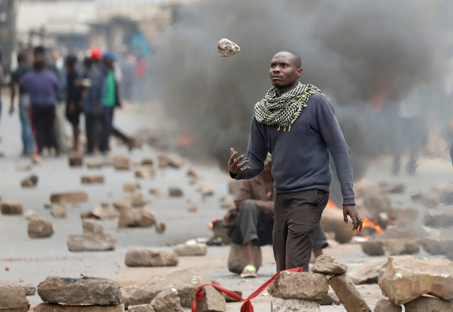 A supporter of opposition leader Raila Odinga gestures in front of barricades in Mathare slum, in Nairobi, Kenya, August 9, 2017. (Photo by Goran Tomasevic/Reuters)