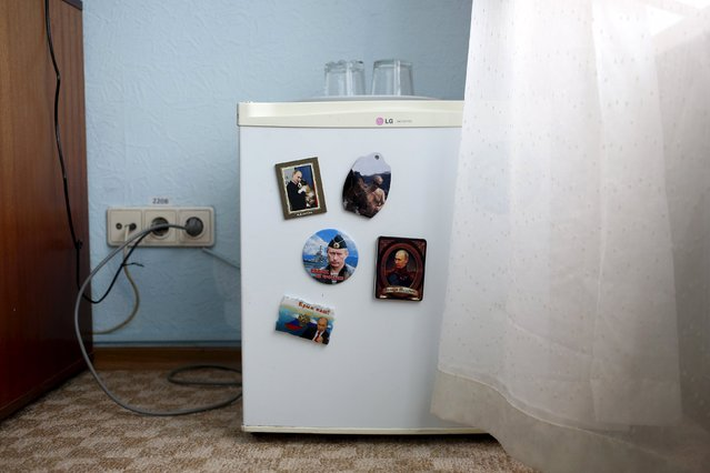 Magnets with pictures of Russian President Vladimir Putin on them are seen on a fridge in this photo illustration taken in a hotel room in Kazan, Russia, July 24, 2015. (Photo by Stefan Wermuth/Reuters)