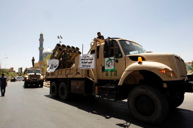 Vehicles of the Hashid Shaabi (Popular Mobilization) take part in a military parade in the streets of Baghdad, Iraq July 12, 2016. (Photo by Khalid al Mousily/Reuters)
