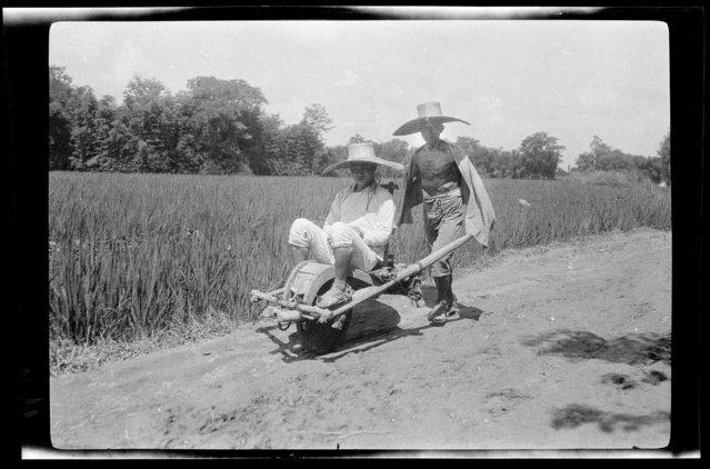 Man Riding Barrow. China, Guan Xian (Sichuan Sheng), 1917-1919. (Photo by Sidney David Gamble)