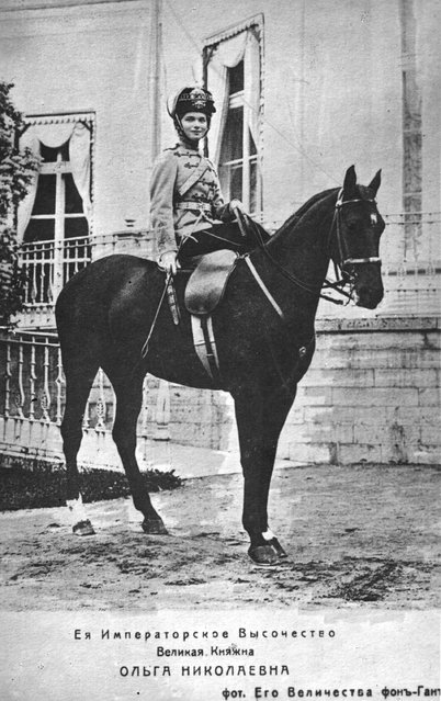 Olga, eldest daughter of Emperor Nicholas II, later Grand Duchess of Russia, on a horse outside a palace, circa 1910.
