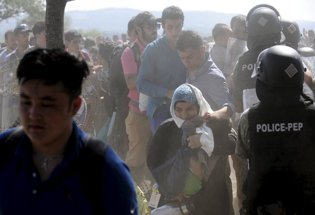 Migrants enter Macedonia near Gevgelija after crossing the border with Greece September 2, 2015. (Photo by Ognen Teofilovski/Reuters)