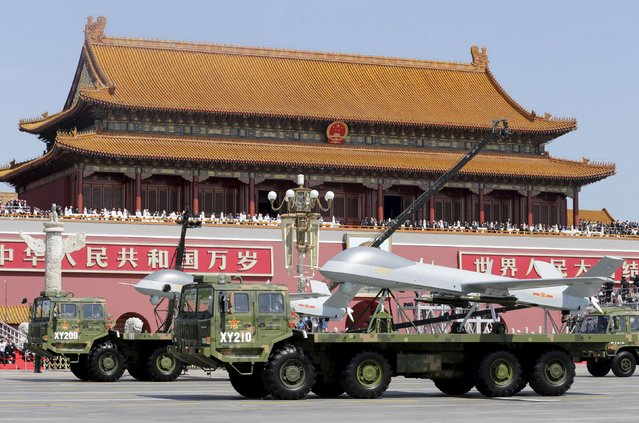 Military vehicles carrying Pterodactyl I unmanned aerial vehicles drive past the Tiananmen Gate during a military parade to mark the 70th anniversary of the end of World War Two, in Beijing, China, September 3, 2015. (Photo by Jason Lee/Reuters)