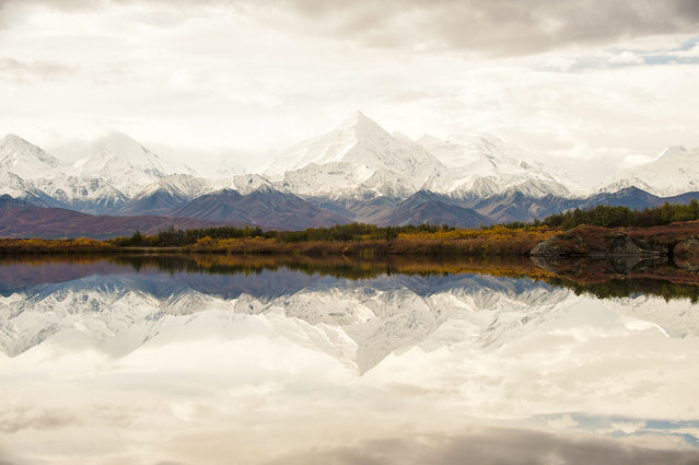 """Alaska Range, Alaska"". Wintry peaks of the Alaska Range are reflected in a pristine pool of water in the high tundra. The photographer, Tim Aiken, is 18 years old. (Photo by Tim Aiken/Smithsonian Wilderness Forever Photo Contest)"
