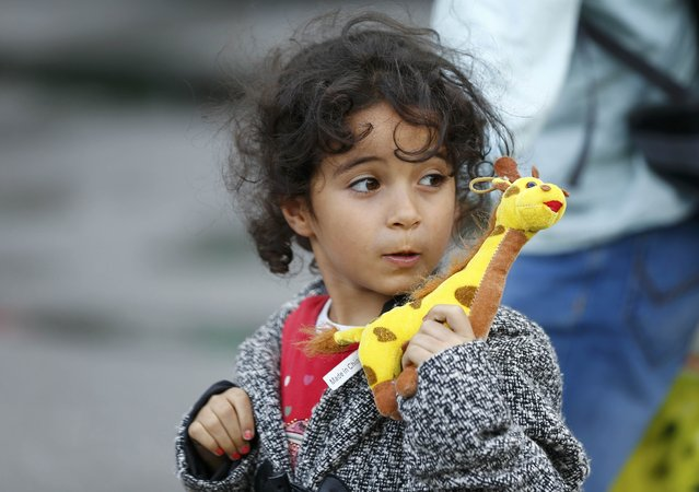 A migrant child walks after arriving by train to the main railway station in Munich, Germany September 6, 2015. (Photo by Michael Dalder/Reuters)