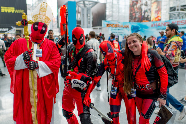 Fans cosplay as Deadpool during 2017 New York Comic Con, Day 1 on October 5, 2017 in New York City. (Photo by Roy Rochlin/Getty Images)
