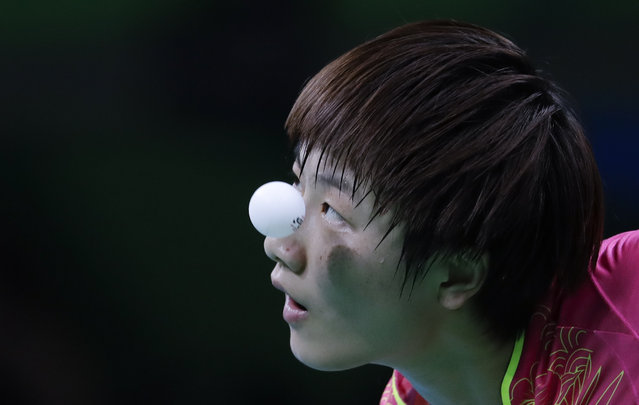 Ding'Ning of China plays against Ying'Han of Germany during their table tennis match at the 2016 Summer Olympics in Rio de Janeiro, Brazil, Tuesday, August 9, 2016. (Photo by Natacha Pisarenko/AP Photo)