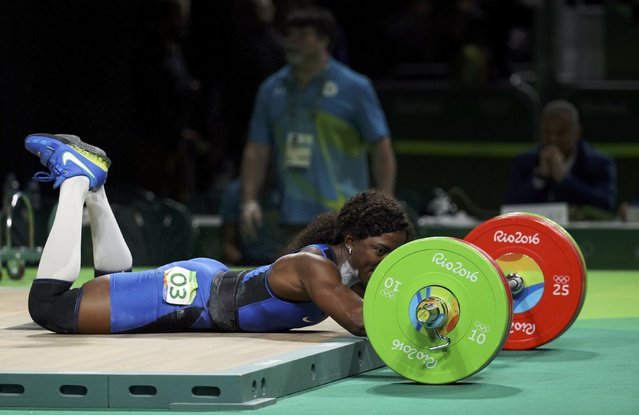 2016 Rio Olympics, Weightlifting, Final, Women's 75kg, Riocentro, Pavilion 2, Rio de Janeiro, Brazil on August 12, 2016. Gaelle Ketchanke (FRA) of France falls as she fails a lift. (Photo by Stoyan Nenov/Reuters)