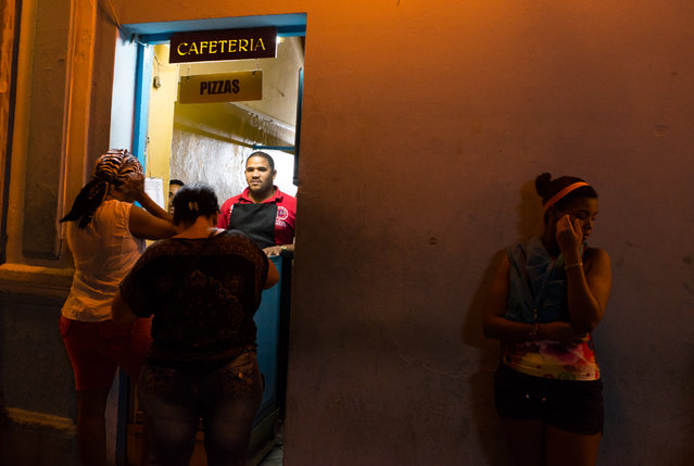 Cubans are pictured ordering food from a window on Obispo Street in the historic center of Havan, Cuba on the night of Thursday, January 22, 2015 in front of La Casa de la Musica in Havana, Cuba. (Photo by Sarah L. Voisin/The Washington Post)