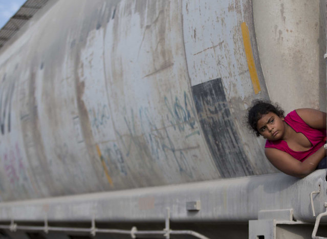 In this July 12, 2014, file photo, a young migrant girl waits for a freight train to depart on her way to the U.S. border, in Ixtepec, Mexico. In a report released Monday, August 21, 2016, the UN children's agency said that thousands of children trying to escape gang violence and poverty in Central America have made their way to the United States this year and there is no sign that the flow is letting up. (Photo by Eduardo Verdugo/AP Photo)
