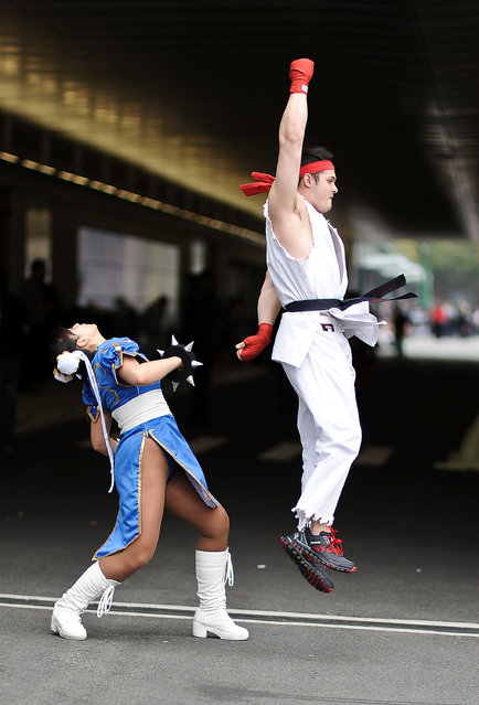 Comic Con attendees pose as Chun Li and Ryu from Street Fighter during the 2014 New York Comic Con at Jacob Javitz Center on October 10, 2014 in New York City. (Photo by Daniel Zuchnik/Getty Images)