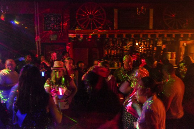 Patrons gather for drinks and dancing at the Globe Tavern on Saturday, February 6, 2016, in Stanley, Falkland Islands. (Photo by Jahi Chikwendiu/The Washington Post)