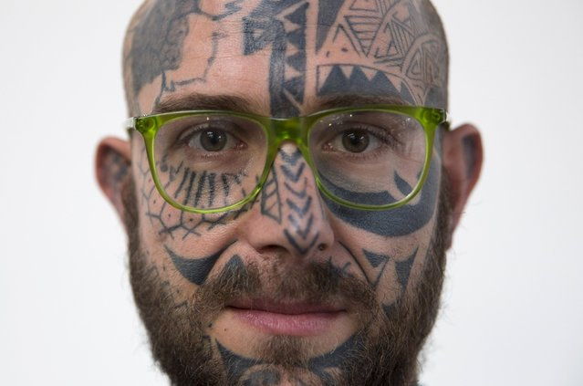 Tattoo enthusiast Simone Lucarelli poses for a portrait during the International London Tattoo Convention in east London, Britain September 26, 2015. (Photo by Neil Hall/Reuters)