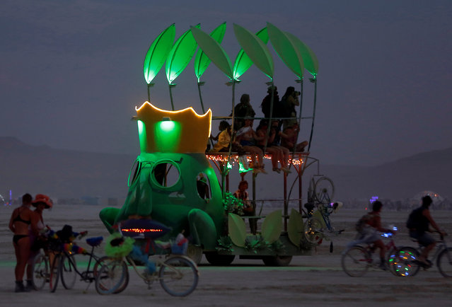 A mutant vehicle drives on the Playa as approximately 70,000 people from all over the world gather for the 30th annual Burning Man arts and music festival in the Black Rock Desert of Nevada, U.S. September 1, 2016. (Photo by Jim Urquhart/Reuters)