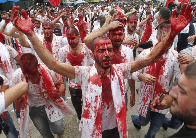 Shi'ite Muslims bleed after tapping their foreheads with a razor during a Muharram procession to mark Ashoura in Nabatieh town, southern Lebanon November 4, 2014. (Photo by Ali Hashisho/Reuters)