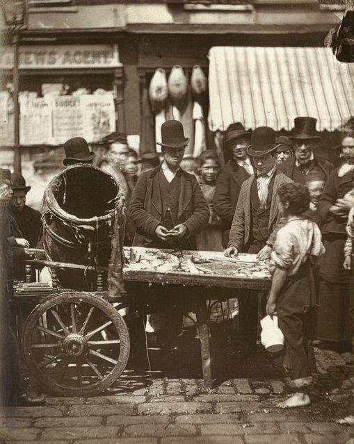 St. Giles Cheap Fish. (Photo by John Thomson/LSE Digital Library)