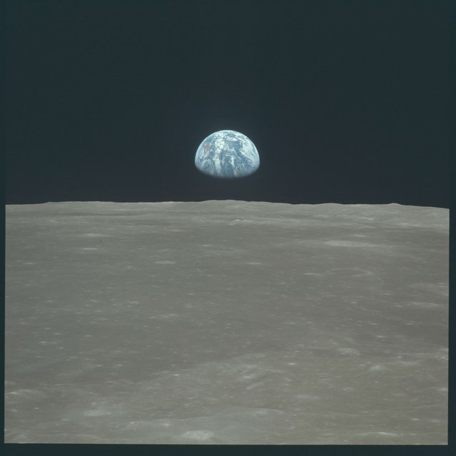 Earth rises above the moon's horizon during the Apollo 11 lunar mission in this July 1969 NASA handout photo. (Photo by Reuters/NASA)