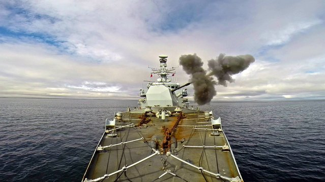 Ministry of Defence undated handout photo of the Royal Navy frigate HMS Iron Duke during high-explosive training in San Carlos Water and Falkland Sound The Portsmouth-based warship, which is in the latter stages of a six-month Atlantic deployment, teamed up with the islands' Roulement Infantry Company and 148 (Meiktila) Battery Royal Artillery for the combined Army-Navy exercise. (Photo by LT CDR C. Hammond/PA Wire)