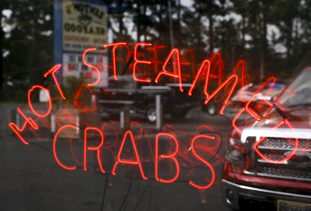 """Linton's Seafood shop and restaurant advertises crabs for sale in the Eastern Shore town of Crisfield, Maryland September 5, 2015. Young people in the small rural shore towns of Chesapeake Bay, which straddles the eastern U.S. states of Maryland and Virginia, are shunning the erratic pay of """"watermen"""", who catch crabs using skills such as baiting a crab pot or handling a trotline, previously passed down through the generations. (Photo by Jonathan Ernst/Reuters)"""