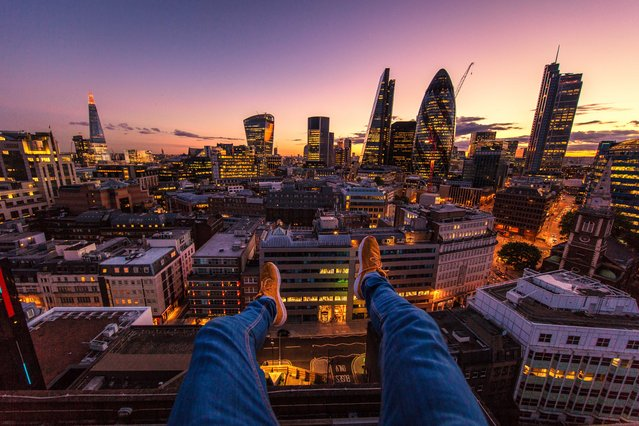 Jacob looking out to the London skyline. (Photo by Jacob Riglin/Caters News)