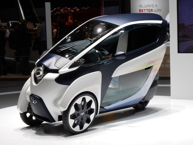 Toyota revealed its i-Road concept, a three-wheeled all-electric motorcycle of sorts that seats two. The unique design is only 33 inches wide, which would make it tops in buzzing in through and around traffic. An Active Lean system tilts the i-Road through corners like a motorbike, while the cabin (which seats two in a tandem layout) is fully enclosed. Maximum range is about 30 miles. (Photo by Luis Fernando Ramos/G1)