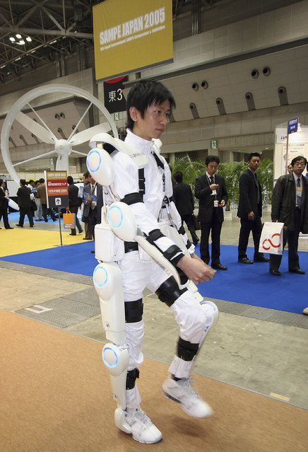 "Robot suit ""Hybrid Assistive Limb (HAL)"" worn by a man developed by University of Tsukuba is seen during 2005 International Robot Exhibition on November 30, 2005 in Tokyo, Japan. By wearing the power suit, it makes it easier to move and lift heavy things. The Exhibition is on until December 3. (Photo by Koichi Kamoshida)"