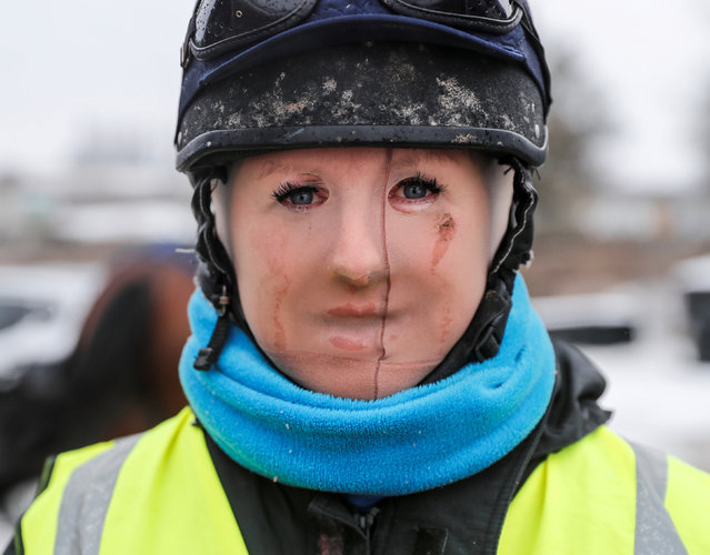 Trainer Lawney Hill poses for a photograph as she wears tights over her face to keep out the cold after taking her horses out on the all-weather gallops in Tetsworth, Britain, March 2, 2018. (Photo by Eddie Keogh/Reuters)