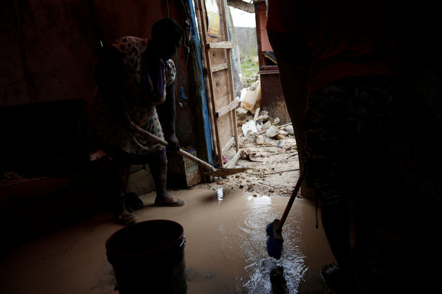 People try to clean the mud at their partially destroyed house after Hurricane Matthew passed Jeremie, Haiti, October 6, 2016. (Photo by Carlos Garcia Rawlins/Reuters)