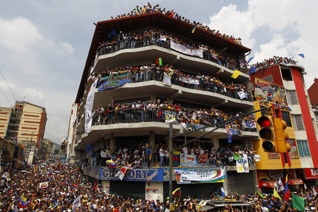 Supporters of Venezuela's opposition leader and presidential candidate Henrique Capriles attend a campaign rally in the state of Merida April 10, 2013. Venezuelans will hold presidential elections on April 14. (Photo by Carlos Garcia Rawlins/Reuters)