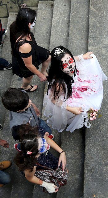 "Revellers attend the ""Zombie Walk"" parade in Sao Paulo, Brazil, November 2, 2015. (Photo by Paulo Whitaker/Reuters)"