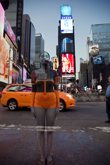 A woman blends into the wolrd famous Times Square in New York City, US. (Photo by Trina Merry/Caters News)