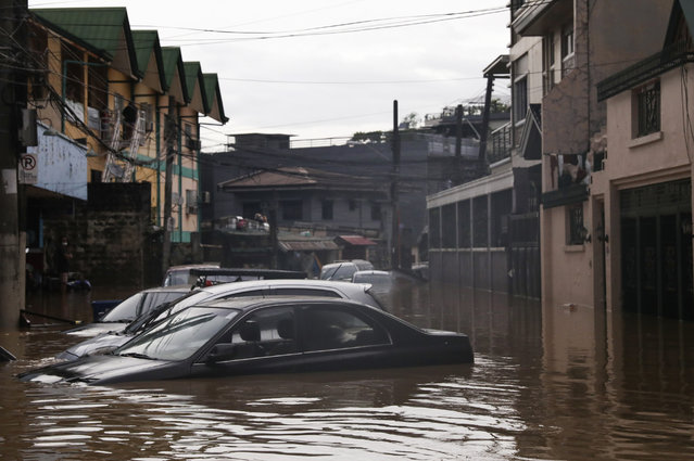 Vehicles are seen submerged in flood waters due to heavy rains brought by Typhoon Vamco in Marikina City east of Manila, Philippines, Thursday. November 12, 2020. (Photo by Basilio Sepe/AP Photo)