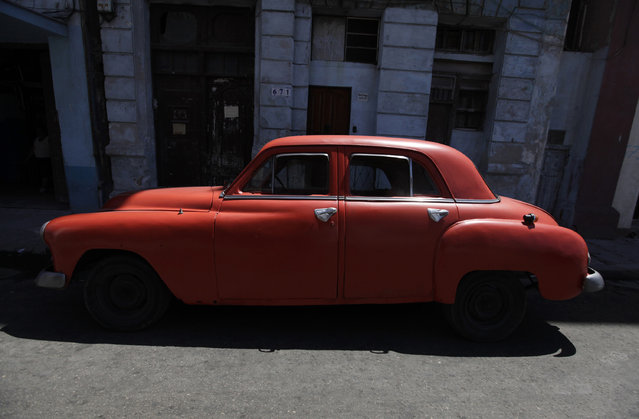 A 1951 Plymouth car parked on a street in Havana, April 13, 2010. (Photo by Enrique De La Osa/Reuters)