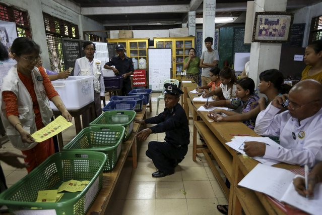 Volunteers count votes at a polling station during Myanmar general elections in central Yangon, November 8, 2015. (Photo by Soe Zeya Tun/Reuters)