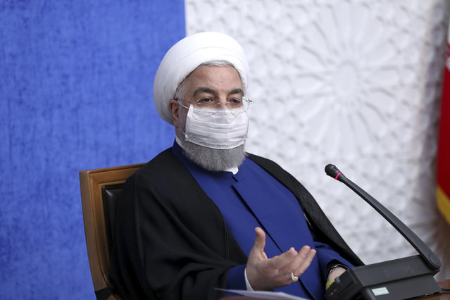 """In this photo released by the official website of the office of the Iranian Presidency, President Hassan Rouhani speaks in a meeting in Tehran, Iran, Sunday, November 8, 2020. On Sunday, Rouhani called on President-elect Joe Biden to """"compensate for past mistakes"""" and return the U.S. to Tehran's 2015 nuclear deal with world powers. (Photo by Iranian Presidency Office via AP Photo)"""