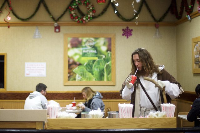 "Michael Grant, 28, ""Philly Jesus"", sips from a free cup of water at a Wendy's restaurant in Philadelphia, Pennsylvania December 14, 2014. (Photo by Mark Makela/Reuters)"