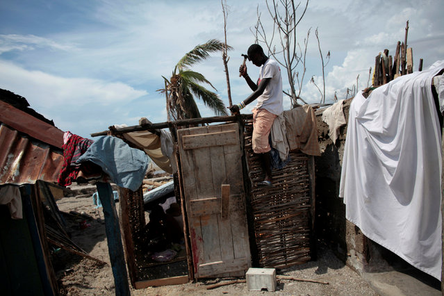 A man builds a new house after Hurricane Matthew in Chardonnieres, Haiti, October 17, 2016. (Photo by Andres Martinez Casares/Reuters)