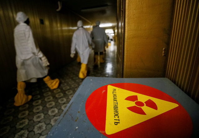 Journalists walk through the corridor of the stopped third reactor at the Chernobyl nuclear power plant in Chernobyl, Ukraine April 20, 2018. (Photo by Gleb Garanich/Reuters)