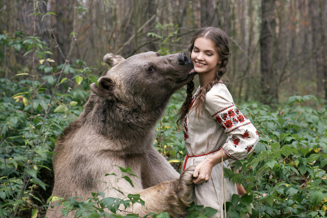 """Marina with a bear"". Stepan, a 700-pound grizzly bear, was adopted by a Russian couple when he was just 3 months old. (Photo by Olga Barantseva/Caters News Agency)"