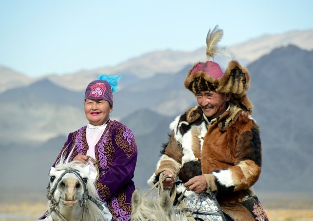 A husband and wife dressed in traditional Kazakh clothing during the opening ceremonies of the Eagle Hunting Festival. (Photo by Brad Ruoho/The Star Tribune)