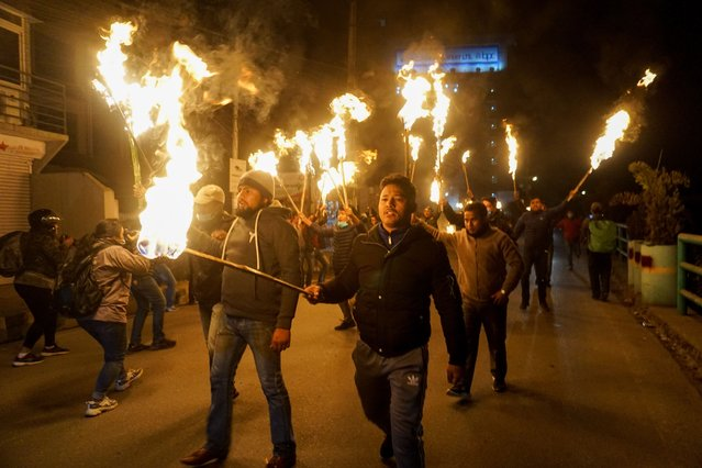 Nepalese protesters carrying torches during a rally to protest against Nepal's Prime Minister Khadga Prasad Sharma Oli, in Kathmandu, Nepal on December 24, 2020. Nepal's President Bidya Devi Bhandari approved to dissolve the parliament and declare general elections to be held in two phases on April 30 and May10. (Photo by Sunil Prdhan/Anadolu Agency via Getty Images)