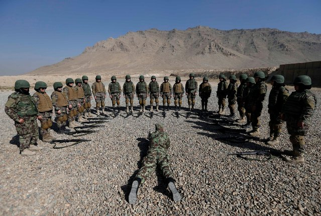 Female soldiers from the Afghan National Army (ANA) take part in a training exercise at the Kabul Military Training Centre (KMTC) in Kabul, Afghanistan October 26, 2016. (Photo by Mohammad Ismail/Reuters)
