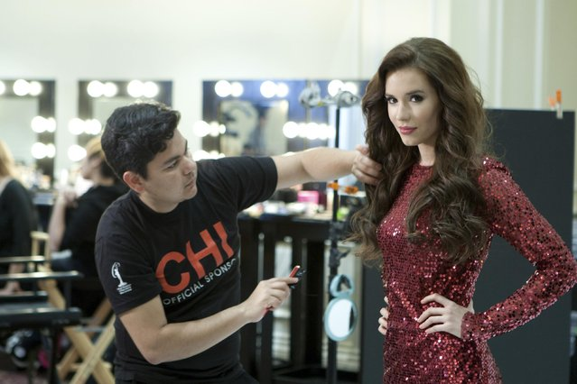 Miss Hungary 2014 Henrietta Kelemen gets her hair done at the 63rd annual Miss Universe Pageant in Miami, Florida, in this January 5, 2015 handout photo provided by the Miss Universe Organizatio. (Photo by Reuters/Miss Universe Organization)