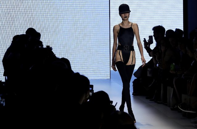 A model wears a creation from Amir Slama collection during the Sao Paulo Fashion Week in Sao Paulo, Brazil, Wednesday, October 26, 2016. (Photo by Andre Penner/AP Photo)
