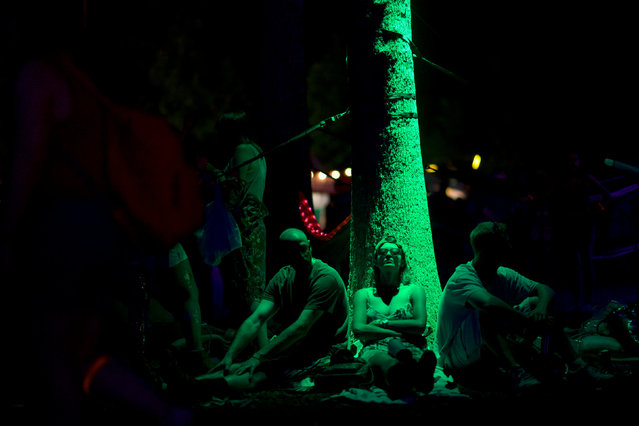 Concert goers rest against a tree after The Killers performed on the third day of the Firefly Music Festival in Dover, Delaware U.S., June 16, 2018. (Photo by Mark Makela/Reuters)