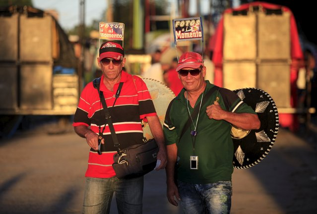 Photographers Jesus (L), 52, and Rodolfo, 55, pose for a picture in Vertientes, Camaguey province November 13, 2015. Picture taken November 13, 2015. (Photo by Enrique de la Osa/Reuters)