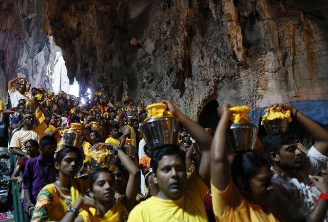 Hindu devotees carry pots of milk on their heads while on their pilgrimage to the Batu Caves temple during Thaipusam in Kuala Lumpur February 3, 2015. (Photo by Olivia Harris/Reuters)