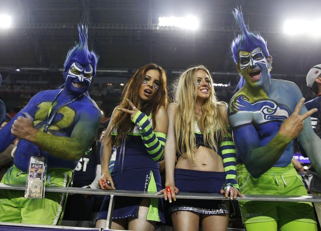 Seattle Seahawks fans cheer during the NFL Super Bowl XLIX football game against the New England Patriots in Glendale, Arizona, February 1, 2015. (Photo by Lucy Nicholson/Reuters)
